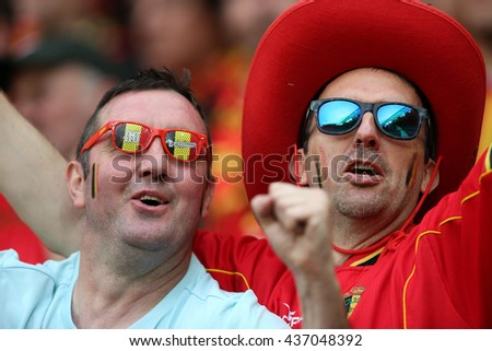 LYONE- FRANCE,JUNE 2016:fans of Italy and Belgium in the stands before football match  of Euro 2016 in France between Belgium vs Italy at the Grand Stade Olympique Lyonnais on June 13, 2016 in Lyone.