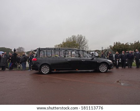 LYTHAM ST ANNES, UK 11TH November 2013. Hearse carryng coffin of WWII was Veteran arrives at Lytham Park Cemetary. - stock photo