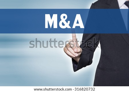 M and A (Merger and Acquisition) Business woman pointing at word for business background concept - stock photo