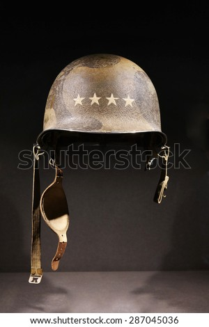 M1 combat helmet. A World War Two period American U.S. Army soldier's steel combat helmet with four-star insignia of the rank of General on it. - stock photo