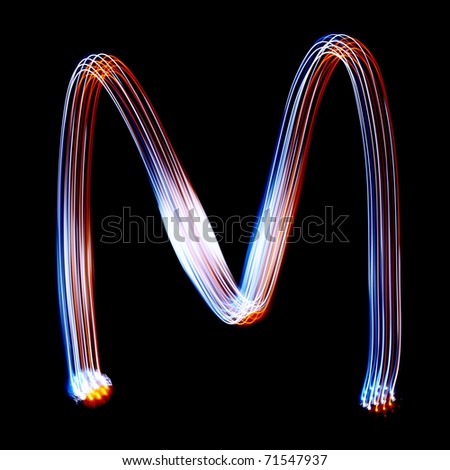 M - Created by light colorful letters over black background - stock photo