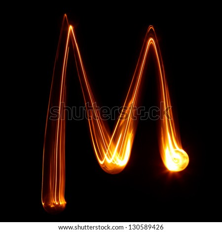M - Pictured by light letters - stock photo