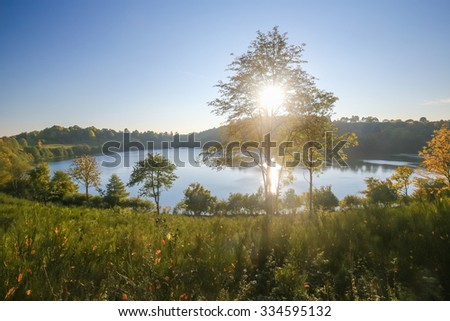Maar or Volcanic Lake in the Vulkaneifel district in Rhineland-Palatinate, Germany. - stock photo