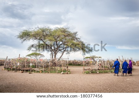 Maasai Village ,In the centre of the village is the big tree that use to be the place to  sell souvenirs for tourists. - stock photo