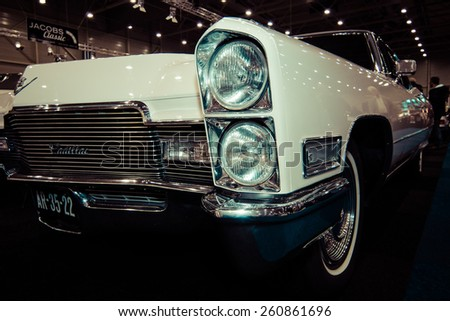 MAASTRICHT, NETHERLANDS - JANUARY 09, 2015: Detail of a full-size luxury car Cadillac Sixty Special (Ninth generation). Vintage toning. Stylization. Int. Exhibition InterClassics & Topmobiel 2015 - stock photo