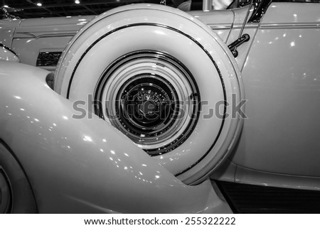 MAASTRICHT, NETHERLANDS - JANUARY 08, 2015: Fragment of a car Packard 120 Convertible Sedan with Dietrich Body, 1937. Black and white. International Exhibition InterClassics & Topmobiel 2015 - stock photo