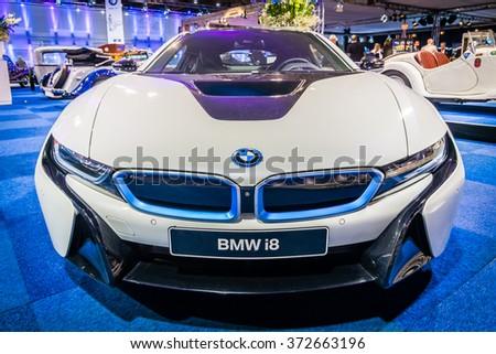 MAASTRICHT, NETHERLANDS - JANUARY 14, 2016: Plug-in hybrid sports car BMW i8. International Exhibition InterClassics & Topmobiel 2016 - stock photo