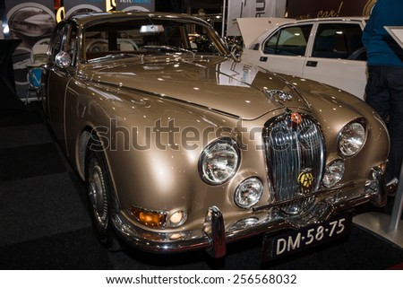 MAASTRICHT, NETHERLANDS - JANUARY 09, 2015: Sports saloon Jaguar S-Type, 1965. International Exhibition InterClassics & Topmobiel 2015 - stock photo
