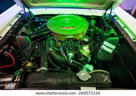 MAASTRICHT, NETHERLANDS - JANUARY 09, 2015: The engine V8 4200cc (260CUI) of a Ford Mustang in the original illumination, 1964. International Exhibition InterClassics & Topmobiel 2015