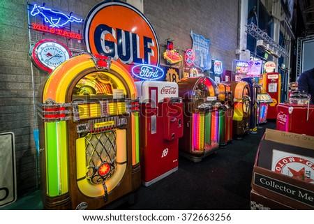 MAASTRICHT, NETHERLANDS - JANUARY 14, 2016: Various retro jukeboxes and retro refrigerator Coca-Cola. International Exhibition InterClassics & Topmobiel 2016 - stock photo
