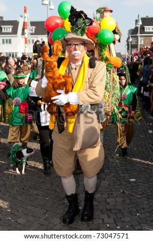 MAASTRICHT, THE NETHERLANDS - MARCH 6: Unidentified man in the Carnival parade dressed as bush explorer on March 6, 2011 in Maastricht, The Netherlands. This parade is organized every year with about 100,000 visitors - stock photo