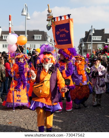 MAASTRICHT, THE NETHERLANDS - MARCH 6: Unidentified men and women in the Carnival parade on March 6, 2011 in Maastricht, The Netherlands. This parade is organized every year with about 100,000 visitors. - stock photo