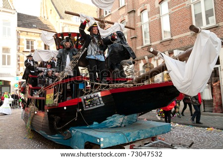 MAASTRICHT, THE NETHERLANDS - MARCH 6: Unidentified people in the Carnival parade dressed as pirates on March 6, 2011 in Maastricht, The Netherlands. This parade is organized every year with about 100,000 visitors. - stock photo