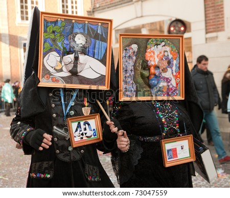 MAASTRICHT, THE NETHERLANDS - MARCH 6: Unidentified persons in the Carnival parade dressed as paintings on March 6, 2011 in Maastricht, The Netherlands. This parade is organized yearly with about 100,000 visitors. - stock photo