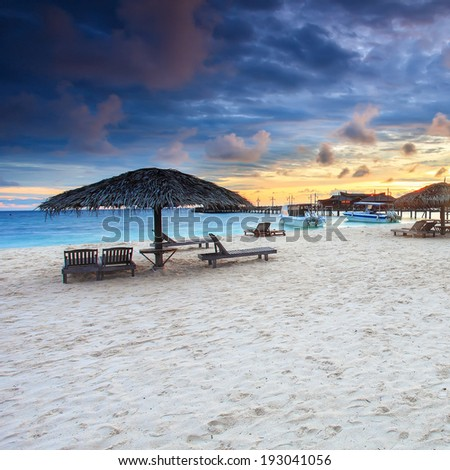 Mabul Island Sunrise view, white sand and turquoise ocean, Sabah, Borneo, Malaysia - stock photo