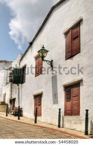 Macao street with stone lane and buildings in daytime. - stock photo