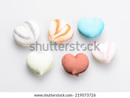 macaron in heart shape on white background - stock photo