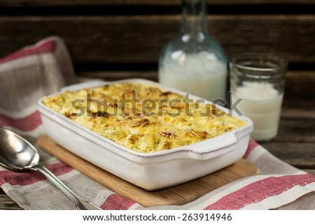 Macaroni and cheese gratin casserole  with feta. Rustic style - stock photo