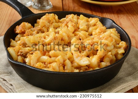 Macaroni and cheese with hamburger in a cast iron skillet - stock photo