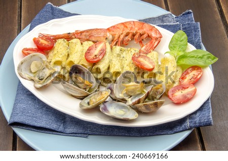 Macaroni carbonara sauce and seafood served on a plate - stock photo
