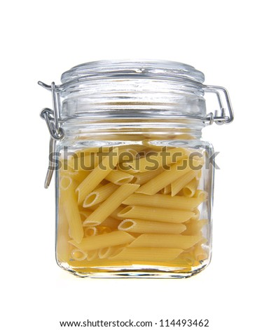 Macaroni in glass jar on a white background
