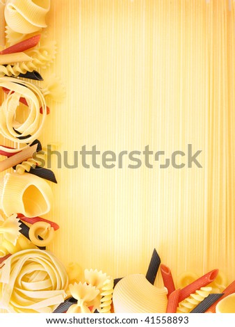 Macaroni on a spagetties background - stock photo