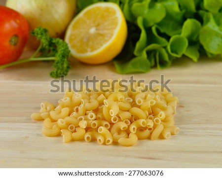 macaroni pasta close up  on wooden background - stock photo