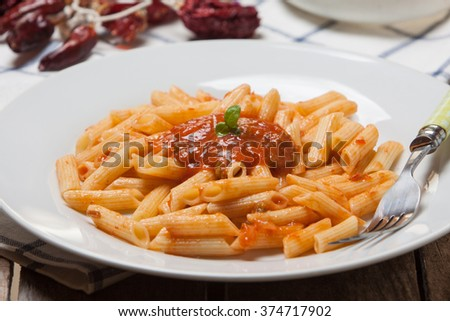 macaroni pasta with hot chili tomato sauce and basil - stock photo