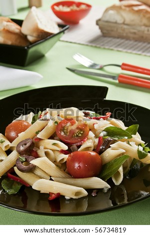 Macaroni salad. Food photography. Italian cuisine accompanied with salad. - stock photo