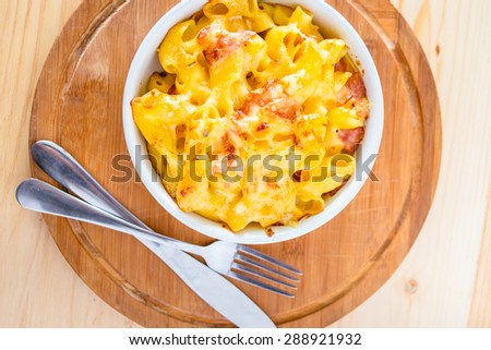 Macaroni with cheese and bacon - stock photo