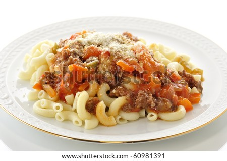 macaroni with sauce and vegetables - stock photo
