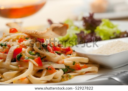 Macaroni with vegetables and cheese - stock photo