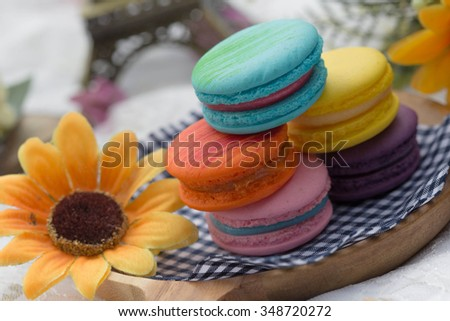 Macarons and sunflower afternoon tea. - stock photo