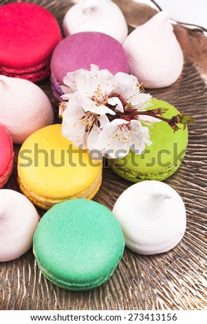 macaroon, marshmallow and flower on a vintage silver tray - stock photo