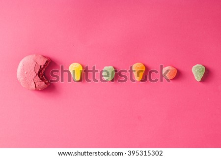 Macaroon with jelly beans on pink background. Flat lay - stock photo