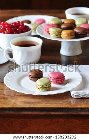 Macaroons and tea - stock photo