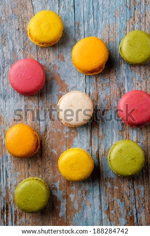 Macaroons on a wooden baclground