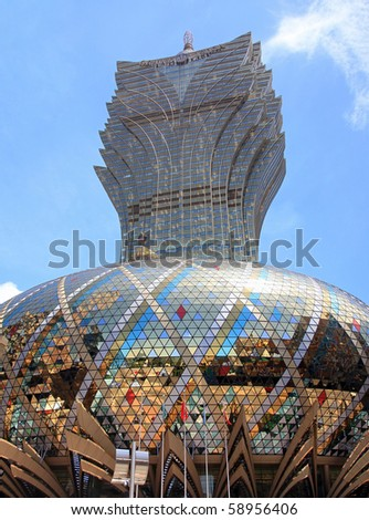 MACAU - AUGUST 1: The Grand Lisboa, Hotel and casino, is seen on August 1, 2010 in Macau, China. Macau is the gambling capital of Asia and one of the world's top gambling destinations. - stock photo