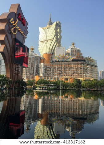 MACAU, CHINA - DECEMBER 30, 2013 - grand lisboa view of Grand Lisboa Macau in China one of the oldest casino and resort in the Chinese gambling capital - stock photo
