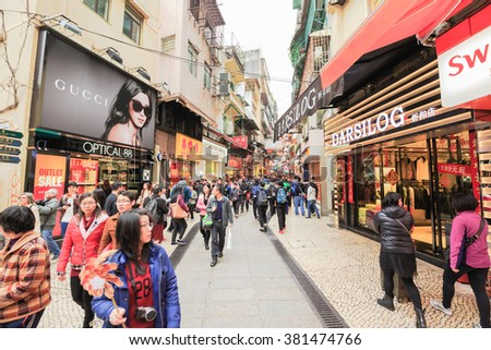 MACAU, CHINA - FEBRUARY 22, 2016:Many people walking and shopping at street to Ruins of St. Paul, It has many shops for Tourists to buy or eat.
