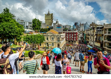 Macau, China - July 12th 2016 - Big concentration of tourists enjoying a cloudy summer day in the historical downtown of Macau in China, Asia.