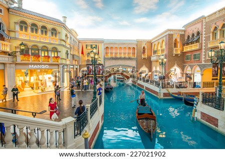MACAU, CHINA - MAY 10, 2014: Interior of Venetian Casino in Taipa. The famous shopping mall, luxury hotel and the largest casino in the world - stock photo