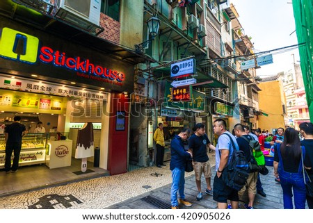 MACAU, CHINA - OCT 22: Visitors visit the famous souvenir street in Macau on October 22, 2015. Chinese tourists are the main resource in Macau tourism industry now.