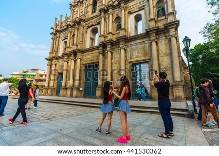 MACAU, CHINA - OCTOBER 22, 2015: Tourist with The ruins of St. Paul's. Built from 1602 to 1640, one of Macau's best known landmarks. Part of the Historic Centre of Macau, a UNESCO World Heritage Site. - stock photo
