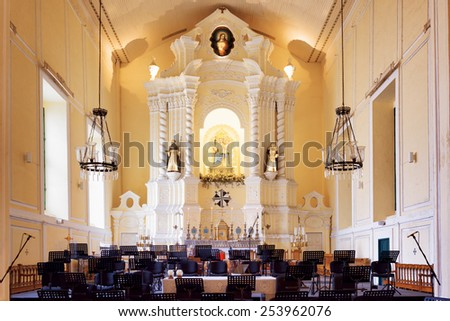 MACAU - JANUARY 30, 2015: Chairs for orchestra musicians in the interior of the St. Dominic Church in Macau. Macau is a popular tourist attraction of Asia and leading casino market of the world.