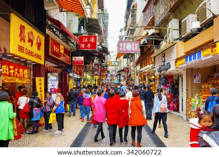 MACAU - JANUARY 30, 2015: Trading in anticipation of the Chinese New Year, of the Spring Festival in the historic centre of Macau. Macau is a popular tourist attraction of Asia in the holidays. - stock photo