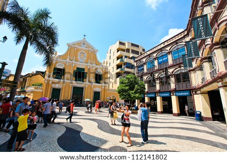 MACAU-JULY 4 : Tourists visit the Historic Centre of Macao on July 4, 2011 in Macau, China. The Historic Centre of Macao was inscribed on the UNESCO World Heritage List in 2005. - stock photo