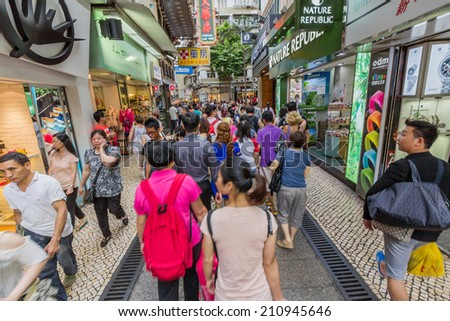 MACAU - JUNE 6, 2014: Crowded streets in Macau. Chinese tourists are the main resource in macau tourism industry now.