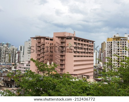 MACAU - JUNE 6, 2014: Kiang Wu Hospital in Macau. Macau has a universally accessible single-payer healthcare system funded by taxes collected by the government from corporations and residents. - stock photo