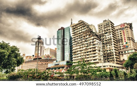 MACAU - MAY 9, 2104: City skyline with modern casinos. Macau has become known worldwide as the Monte Carlo of the Orient and is rivalling Las Vegas because of gambling.